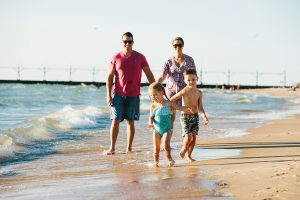 Family of four walking on South Haven beach