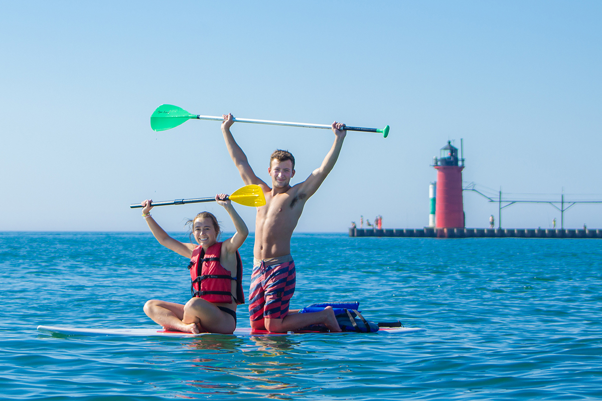 Boy and Girl on paddle board in South Haven