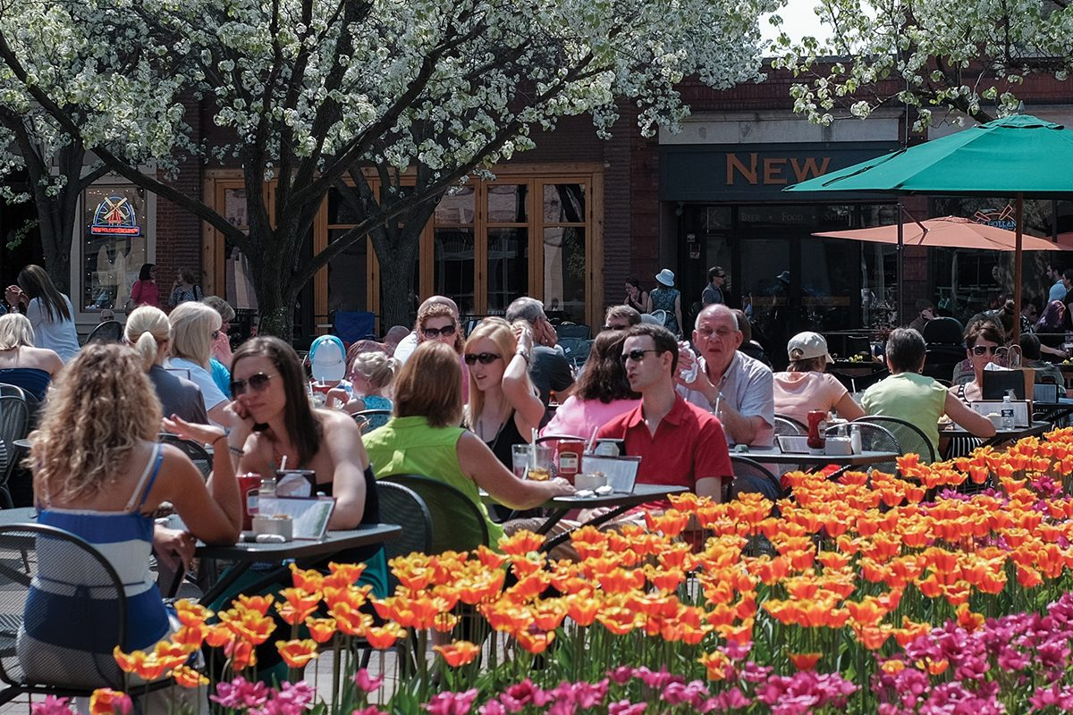 Patrons sitting outside at a Holland restaurant