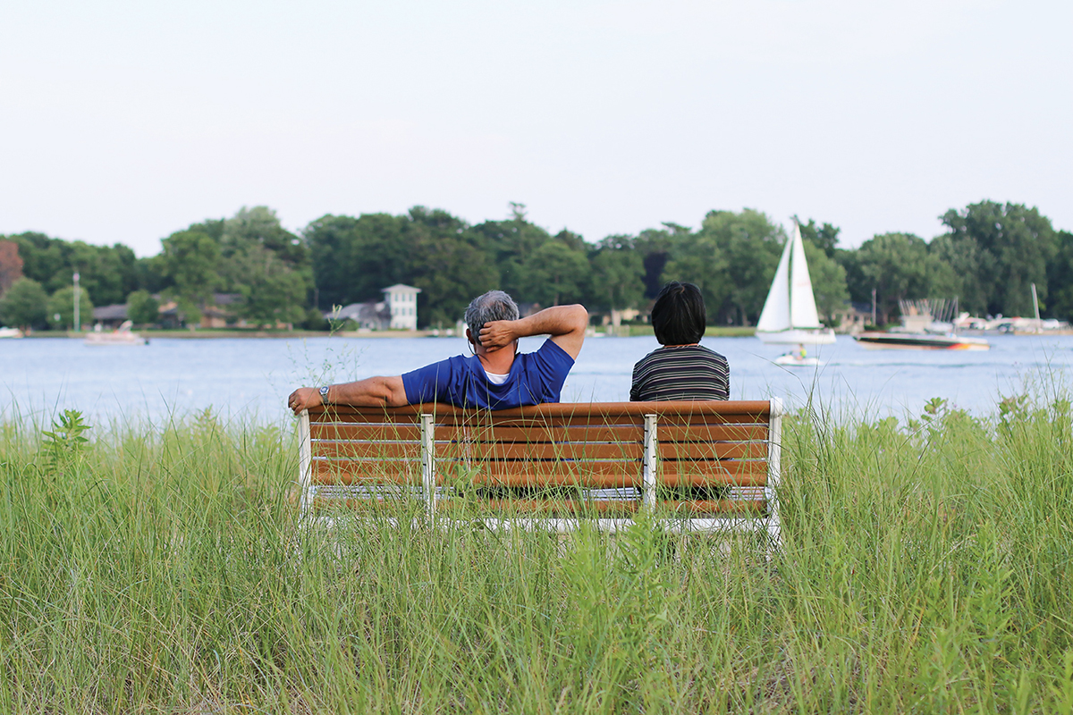 Man and women on bench over looking the water in Holland