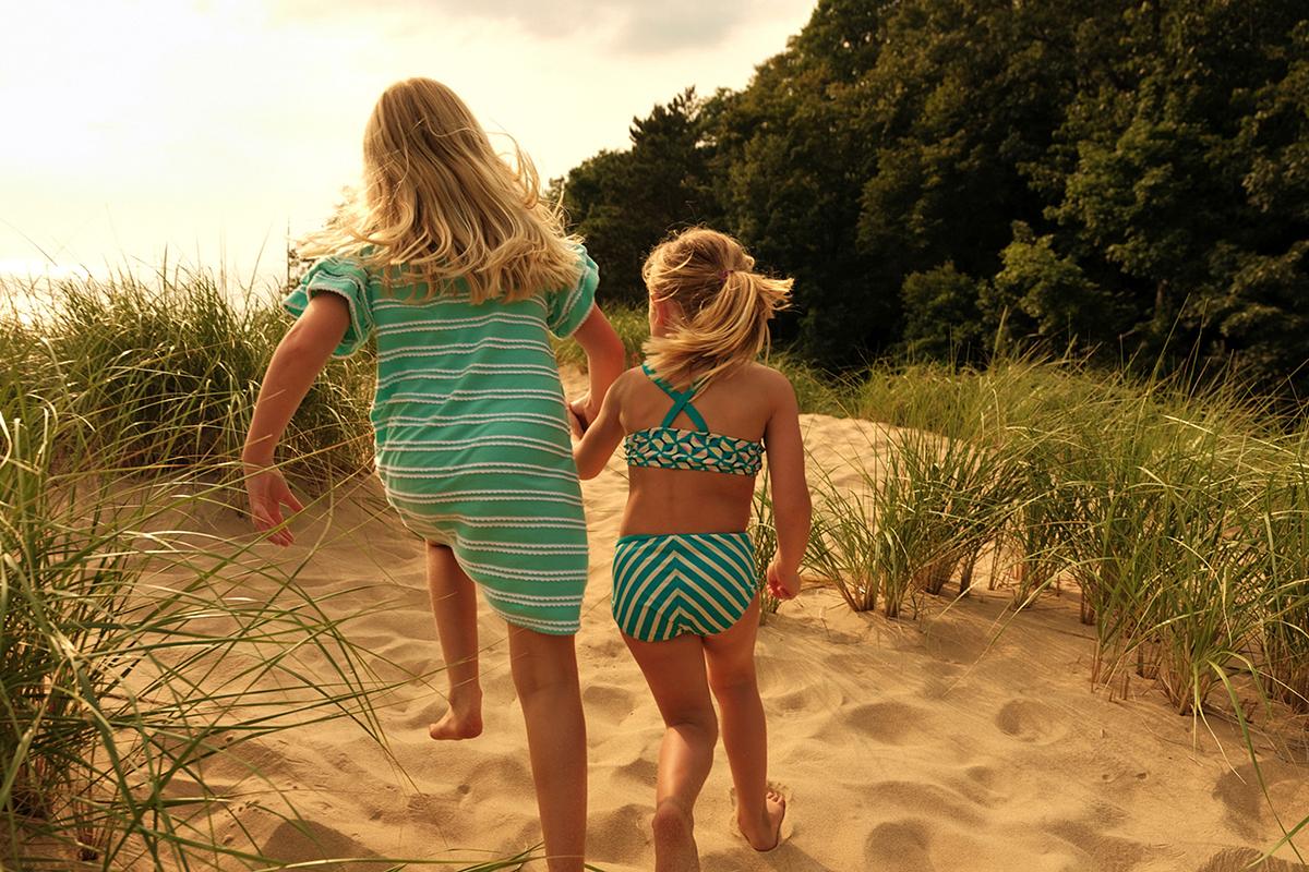 Two girls running on Saugatuck beach